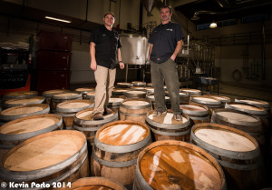 Brewers David and Tim standing on some of FLBC's newly acquired barrels.